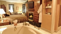 King bed, whirlpool tub for two, large flat screen TV and a blazing fireplace...perfect!