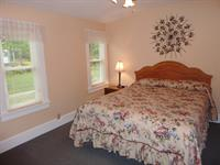 Cottage A's queen bedroom is a sunny respite