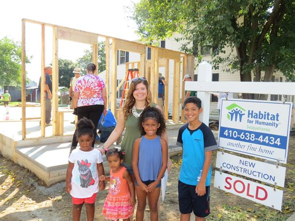 Cecil County Homeowner and Family in front of SOLD sign