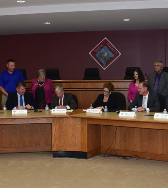 CCPS and Cecil County Government sign a Memorandum of Understanding concerning the new turf field at Perryville High School.