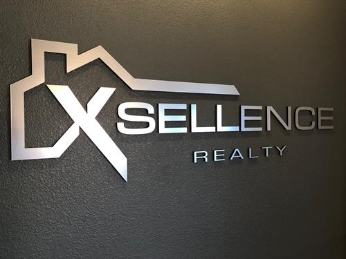 Gallery Image Xsellence_Realty_-_Lobby_Sign.jpg