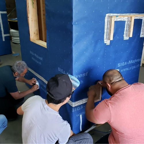 Construction professionals attending an airtight construction training