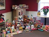 Santo employees collected toys and games to beenfit the Toy For Tots Christmas toy drive
