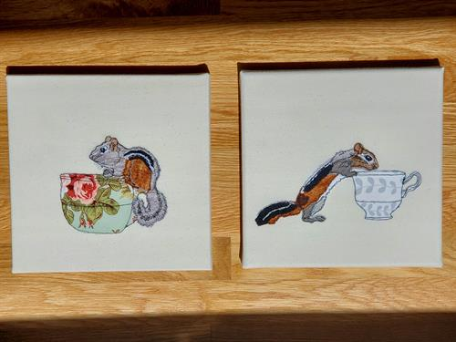 Two chipmunks as wall art mounted over stretched canvas frames.