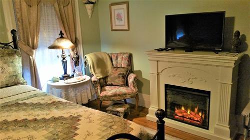 Fleur-de-lis bedchamber with fireplace