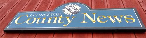 Exterior sign for The Livingston County News, 122 Main St., Geneseo.