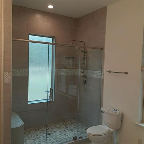 Custom Shower wuth Marble Highlights & Frameless Glass
