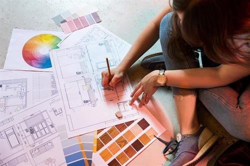 Gallery Image Interior_designer_draws_plan_with_art_tools.jpg