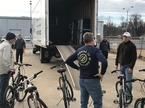 Loading bikes going to the Veterans Administration