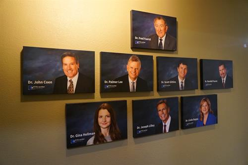Our gallery wall in Citrus Heights, featuring our partner and associate doctors, and founder Fred Fuerst, OD