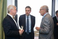 Board members Jim Murphy and Irwin Levy chat with 2017 Annual Dinner speaker, Bret Stephens