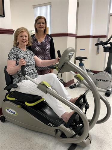 Physical Therapy Assistant Miriam Diaz with a patient