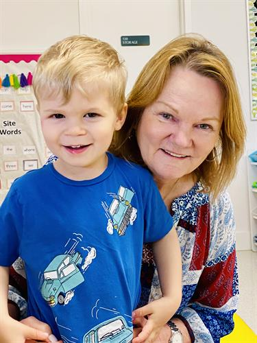 Physical Therapy Assistant Sue Holmes with a preschooler