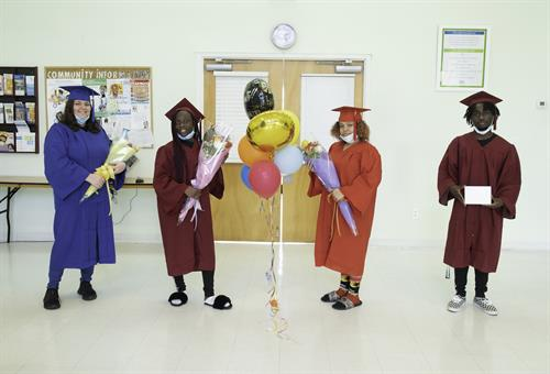 Family Campus residents graduate High School during COVID