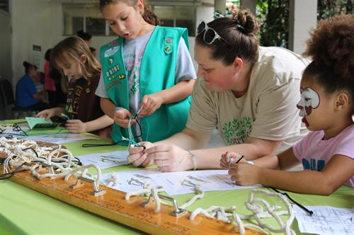 Knot tying is an important skill every Girl Scout should know. Here girls are learning about new knots at our annual Fall into Girl Scouting event.
