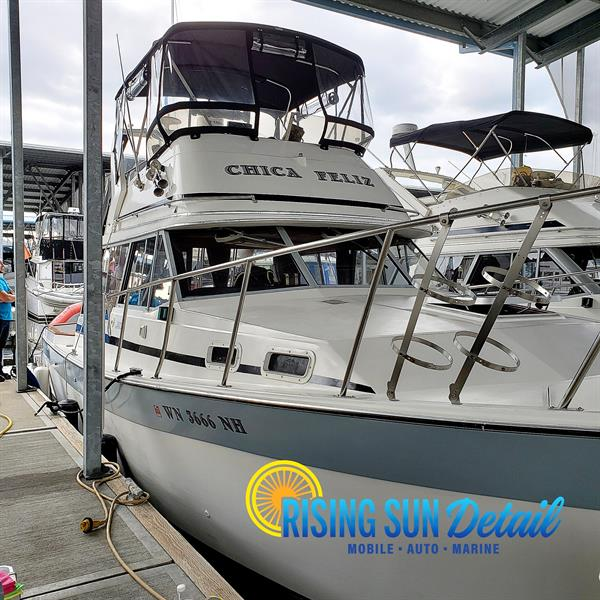 Boat in water at Port Orchard Marina Hand washed and waxed