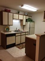 One bedroom-kitchen with full sized appliances, frigerator, stove and dishwasher