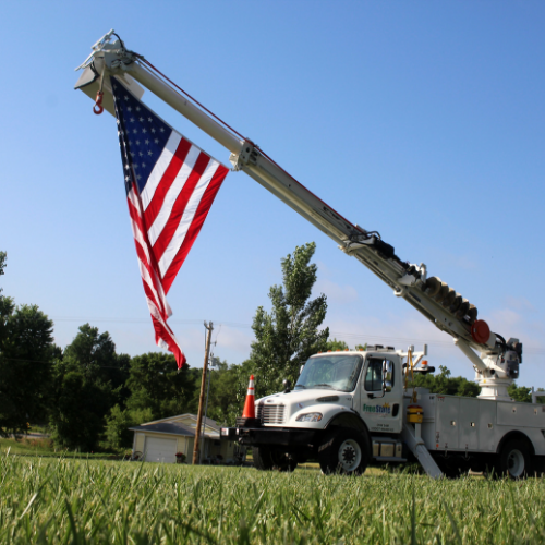 An FEC truck displays the American flag.