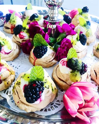 Manner House Tea Room Cherry Pavlovas stuffed with Cherry Cream, Blackberries, a Kiwi Drizzle and garnished with Mint
