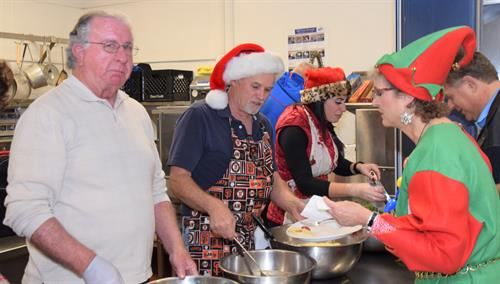 Holiday meal served to local shelter families before Santa arrives via Firetruck.