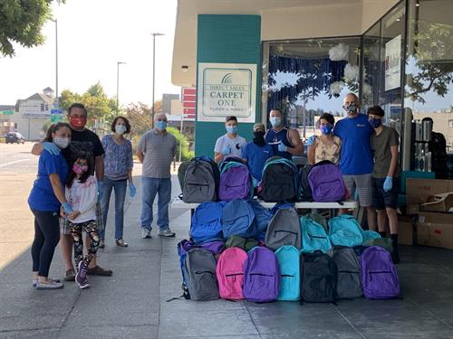 CV Rotary donating backpacks for children in need to CVUSD and Redwood Christian Schools.