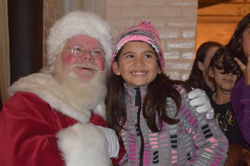 A young girl attending one of the dozens of holiday parties we give for vulnerable youth in the county.