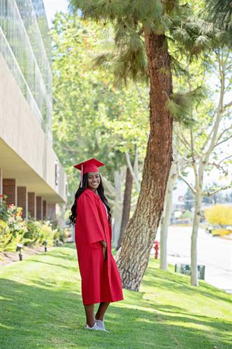 A formerly homeless youth, graduating high school.  She received a college scholarship from Children's Fund.