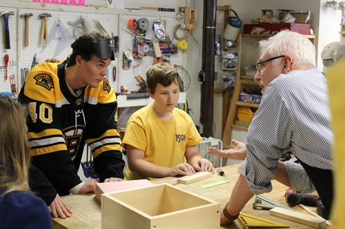 Tuukka Rask of the Boston Bruins visits the wood shop, where he learns about the rehabilitation process from Bill Reynolds, Manual Arts instructor.