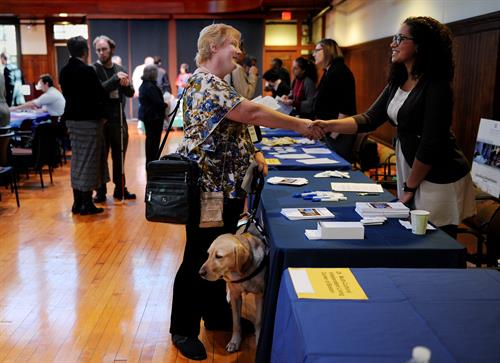A visually impaired job seeker shakes the hand of the potential employer at our annual Job Fair for Individuals with Visual Impairments.