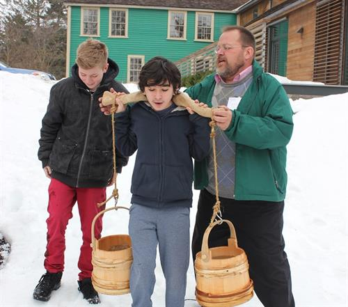 Students learn about 18th century chores
