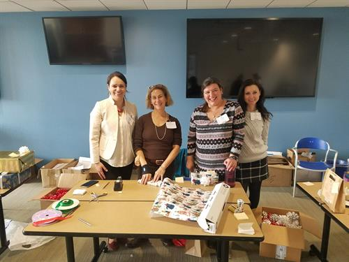 Corporate Gift Wrapping Event. Employees love that they can bring home the wrapped gifts and not worry about that part of the holiday season.