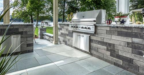 Lineo Garden Wall Used for Grill Island with Unilock Natural Stone Patio.
