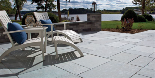 Unilock Natural Stone Patio with Lineo Garden Walls.