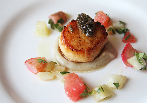 Pan seared scallops, a house favorite.
