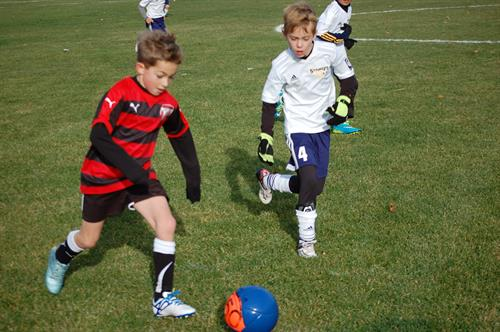 JSSA Premier Soccer club (JSSA boys team in red/black uniform)