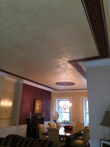 Soft metallic plaster ceiling with stenciling
