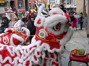 Lion Dance - Commonly associated with the Chinese Lunar New Year when lion dancers parade the streets. Working in teams, members practice choreographed sequences with a costumed lion head accompanied by members practicing traditional Chinese instruments