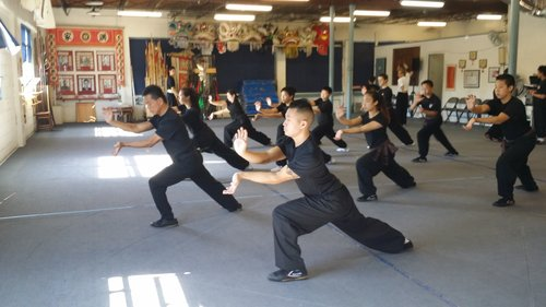 Sifu Calvin Chin leading class - Kung fu is an aerobic form of exercise that first involves learning form sequences and evolves into a discipline of body and mind as theory becomes an integral part of training.