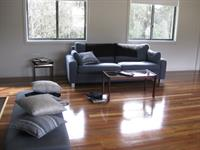 A stunning grey colour palette with Tasmanian Oak flooring for a house in the hills.