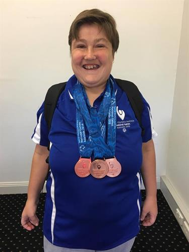 Erina when she returned from the Special Olympics after winning three bronze medals in Bocce.