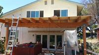 wooden patio cover with heavy timbers