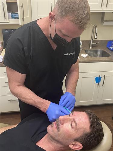 Dr. Koenig working on Dr. Farnesi
