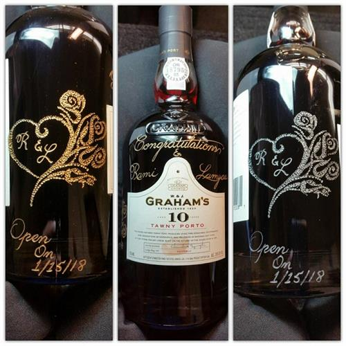 This wine bottle was hand engraved for a Wedding Anniversary.  The heart and roses were hand stippled and colored gold. the rest of the hand engraving was colored silver.