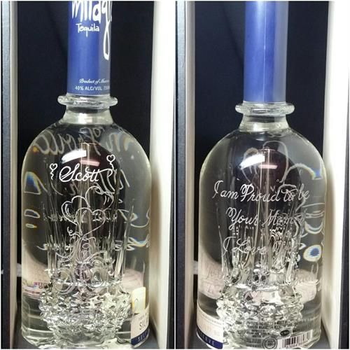 This is a Silver Milagro Tequila. It is a beautiful bottle on its own because it has a glass blown cactus inside. The 50th B-day drawing was engrave on the front an the greeting on the back of the bottle.