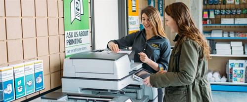 Lauren helping customers with our state-of-the art Ricoh printing equipment.