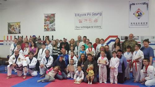 Group photo of students and parents after a great test.