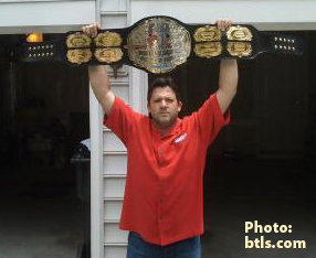 NASCAR's Tony Stewart with his championship belt