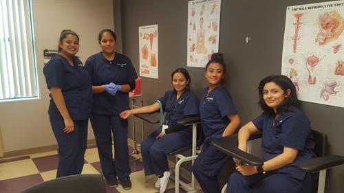 Medical Administrative students during lab practice venipuncture techniques.
