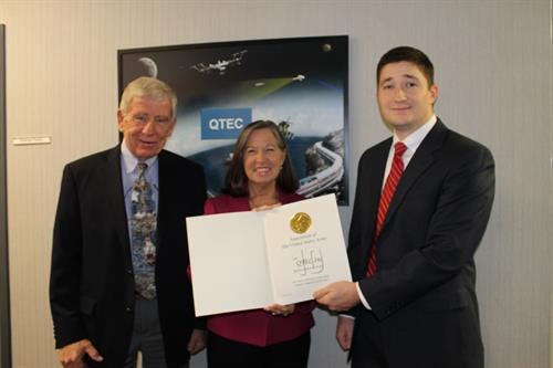 2014 AUSA award to QTEC [l - r, Jim Beveridge, Pres., Kathryn Broad, CEO & AUSA representative]