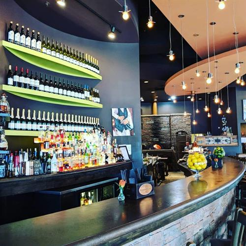 Full bar, wood fire grill and oven, full service catering